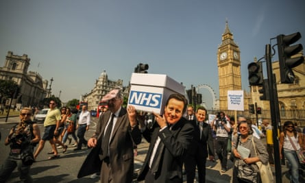 Members of the National Health Action party protest against the gradual privatisation of the NHS, in 2013.