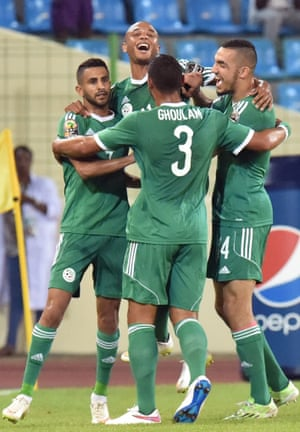 Algeria's Riyad Mahrez, left, is congratulated by team-mates after opening the scoring against Senegal