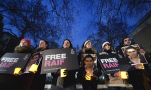 Protesters outside the Saudi embassy in London for a vigil for the blogger Raif Badawi.