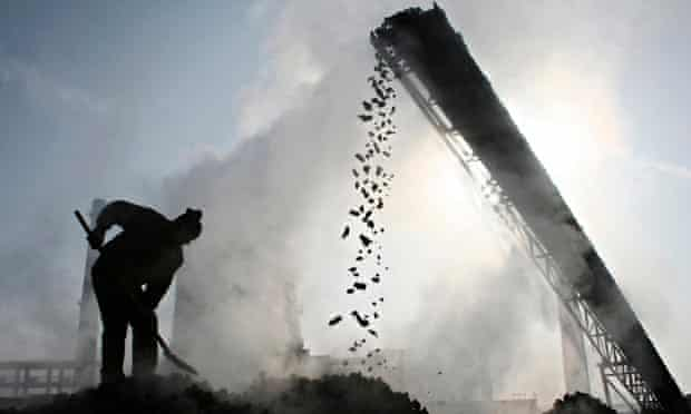 File photo shows a labourer working at a coal factory in Baicheng county