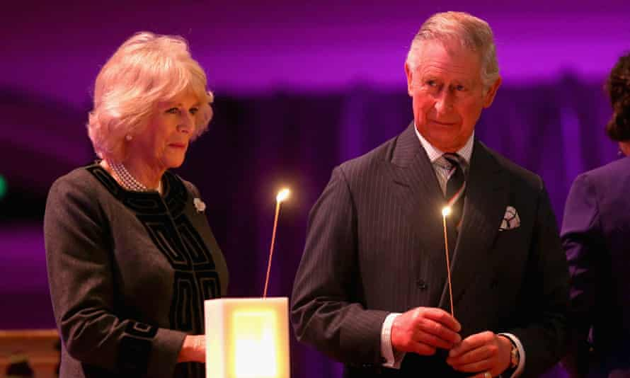 The Prince of Wales and Duchess of Cornwall take part in a candle lighting ceremony on stage at Westminster.