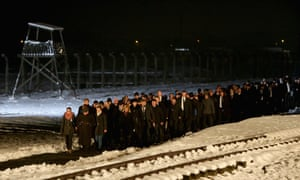 Delegations and survivors make their way to lay candles during the commemoration of the 70th anniversary of the liberation of Auschwitz.