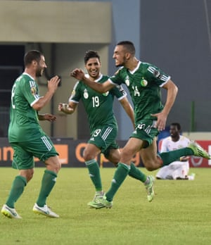 Algeria's midfielder Nabil Bentaleb, right, celebrates after scoring