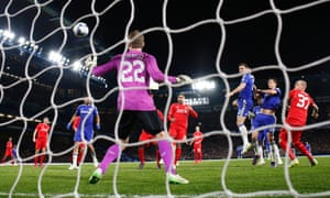 Chelsea's Branislav Ivanovic is unmarked as he rises high to head the ball past Liverpool goalkeeper Simon Mignolet during their Capital One Cup semi-final, second leg at Stamford Bridge.