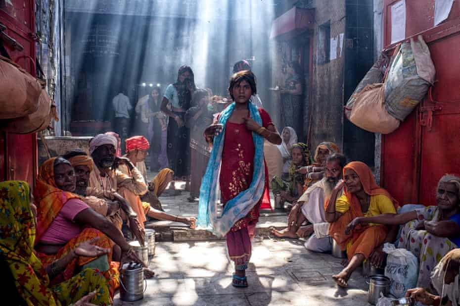 The Emergence, 2012: a young slum dweller caught in an accidental, glamorous shaft of light. Photograph: Prateek Dubey