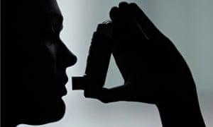 A person using an inhaler