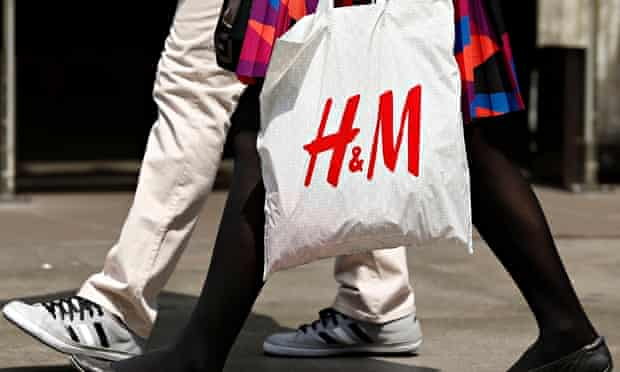 A shopper with an H&M bag on Oxford Street, London