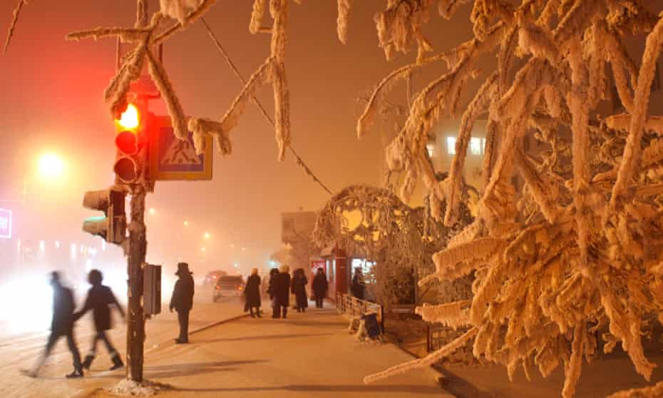 Residents of Yakutsk walk in temperatures of -46C last January.