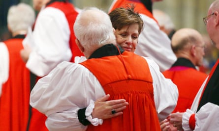 Bishop Libby Lane hugs a member of the clergy during her consecration at York Minster