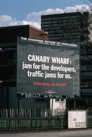 A poster on a Docklands community billboard protests the Canary Wharf development in February 1987.