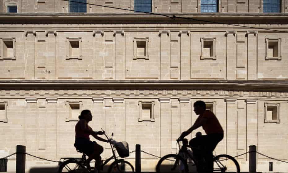 Cyclists on Seville's Avenida de la Constitucion.