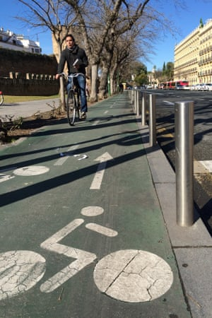 Seville's cyclists are often protected from cars by a kerb and a fence