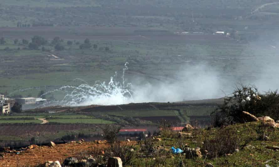 Smoke rises from farms on the junction between Lebanon, Israel and Syria.