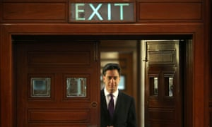 Miliband lurking at a door marked 'Exit'