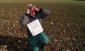 An environmental campaigner protests against Monsanto in a field near Rothwell in Lincs.