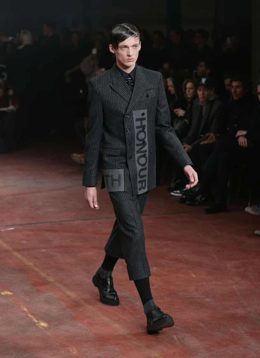 A model wearing a version of men's hoisery on the Alexander McQueen catwalk