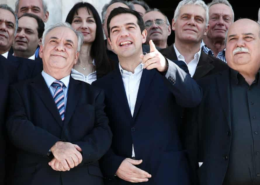 Prime Minister Alexis Tsipras next to Deputy Prime Minister Yannis Dragasakis  after the first meeting of the new cabinet in Athens.