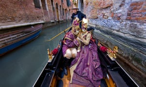 Couple in a gondola at Venice Carnival.