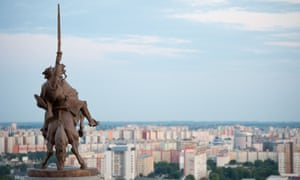 Statue of King Svatopluk with Bratislava in the background.