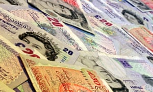 Pound sterling banknotes laid on a table