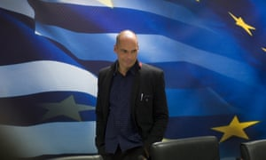 Greece's new Finance Minister Yanis Varoufakis arrives for a handover ceremony at the Finance Ministry in Athens.