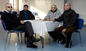 Chandu Pandya, second from the left, plays cards with friends at the Brent Indian Association.