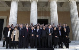 Greece's Prime Minister Alexis Tsipras, center, accompanied by members of his government poses for a group picture outside the Parliament in central Athens, Wednesday, Jan. 28, 2015.