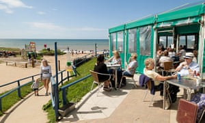 People eating at the Hive Beach cafe, Burton Bradstock, Dorset