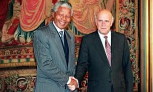 Nelson Mandela and FW de Klerk shake hands on  being awarded the Nobel Peace Prizes in 1993.