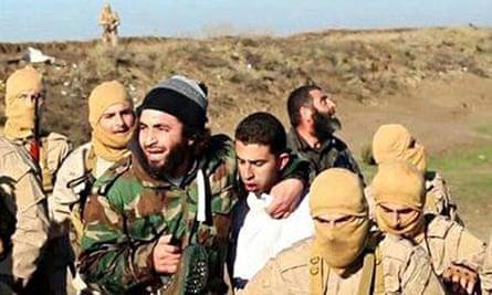Jordanian pilot Muadh al-Kasasbeh after being captured