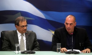 Greece's new finance minister Yanis Varoufakis (right) and outgoing finance minister Gikas Hardouvelis during the handing over of the reins to the finance ministry.