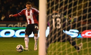 Che Adams directs his shot past Michael Vorm and Sheffield United are back in the game.