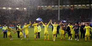 The Tottenham players celebrate their victory.