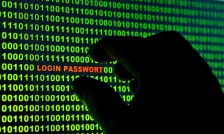 Hand reaching for the words Login Passwort in a binary code gstock computers online security data tech technology internet login password