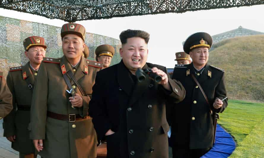 North Korean leader Kim Jong-un (centre) inspects a combined joint military drill.