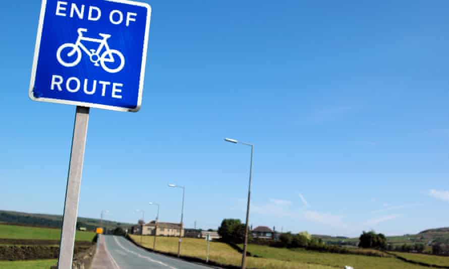 Blue square road sign displaying end of cycle lane
