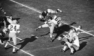 1968 Oakland back Hewritt Dixon dives over Green Bay linebacker Ray Nitschke, No 66, as he squeezes every inch that he can out of a hand off from quarterback Daryle Lamonica