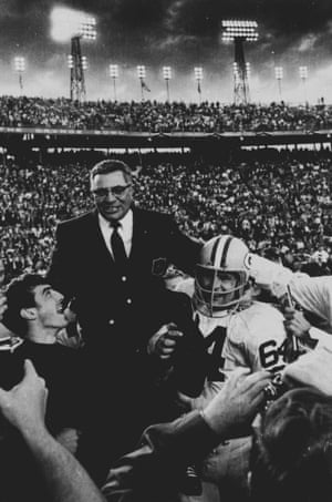 Green Bay Packers coach Vince Lombardi is carried off the field after his team defeated the Oakland Raiders 33 to 14 in Super Bowl II.  Packers guard Jerry Kramer, right, provides one of the shoulders for Lombardi's ride