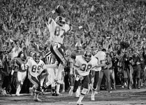 Washington Redskins receiver Charlie Brown (87) spikes the ball after scoring a fourth quarter touchdown, capping the Redskins 27-17 victory over the Miami Dolphins in Super Bowl XVII. Brown led all receivers with six catches for 60 yards, including this 6-yard touchdown pass from Joe Theismann. Joining Brown are teammates Alvin Garrett (89) and Clarence Harmon (38).