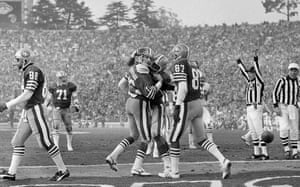 San Francosco 49ers quarterback Joe Montana gets a congratulatory hug from teammate Roger Craig, centre, with Dwight Clark (87) after Montana's second quarter touchdown during the Niners 38-16 victory over the Dolphins