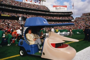 "Entertainer Bob Hope sits in the ""Hopemobile"" during the Super Bowl XXII half-time show"