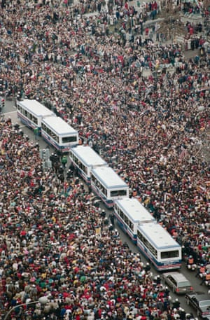 Buses carrying the Washington Redskin players wind their way through the crowd during the victory parade for the Super Bowl champions. A throng estimated in the hundreds of thousands was on hand to cheer for their heroes