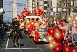 The 49ers Super Bowl Parade makes its way down Market Street in San Francisco, following their 20 to 16 victory over the Cincinnati Bengals. 49ers head coach Bill Walsh is visible in foreground clutching the Super Bowl trophy aka the Vince Lombardi Trophy