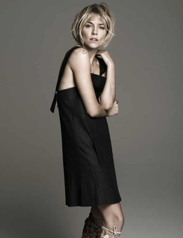 Sienna Miller in a black dress shot at Spring Studios