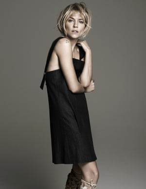 Sienna Miller in a black dress shot at Spring Studios