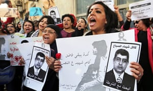 Women demonstrating in Cairo, holding posters of interior minister Mohammad Ibrahim with the words w