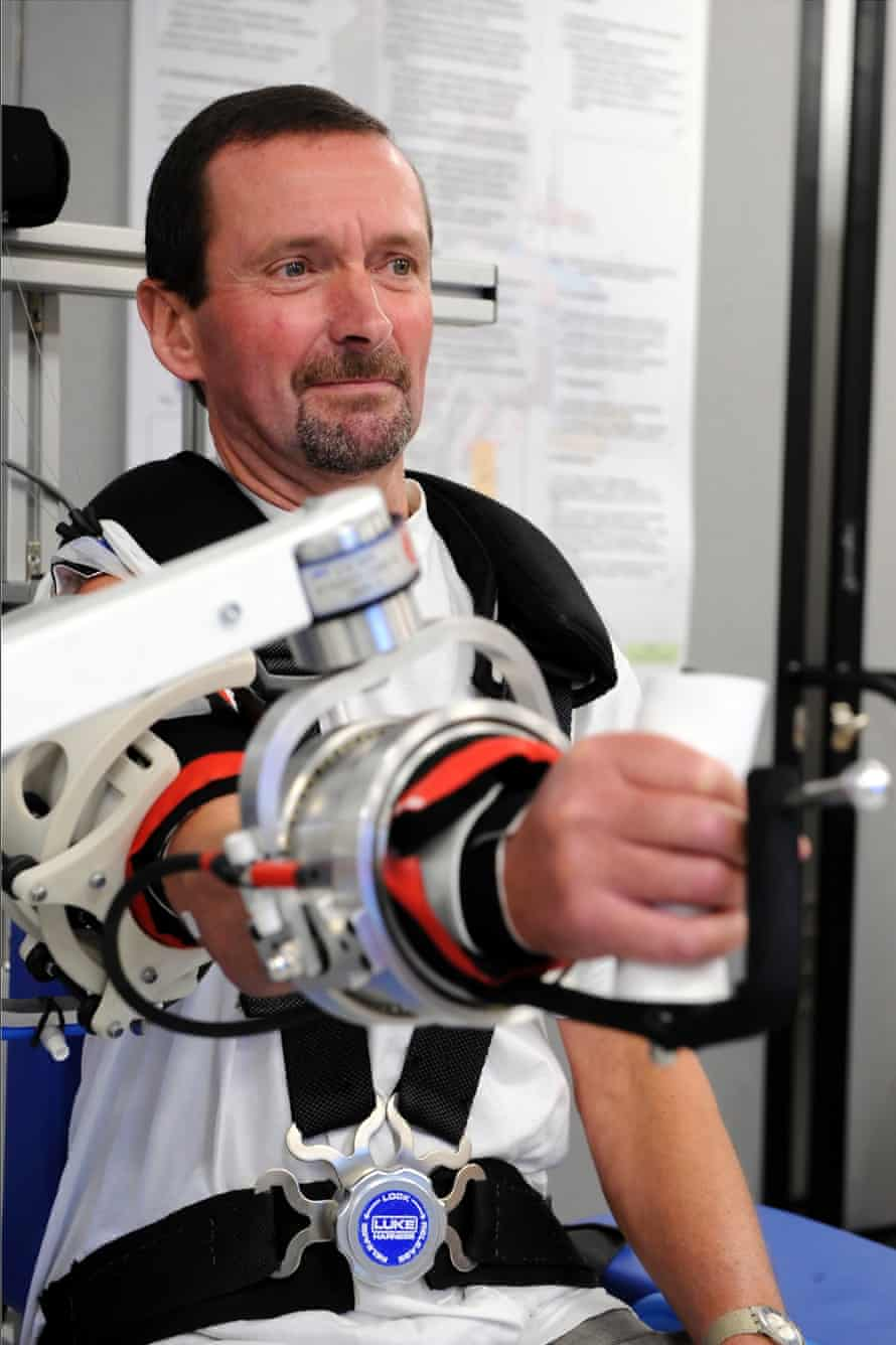 A stroke patient undergoing rehabilitation uses a robot at Leeds General Infirmary.