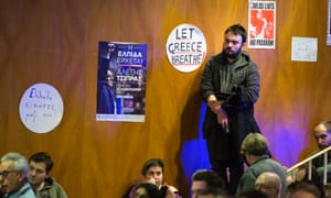 A man listens as speakers celebrate Syriza's victory, at the meeting in London this week.