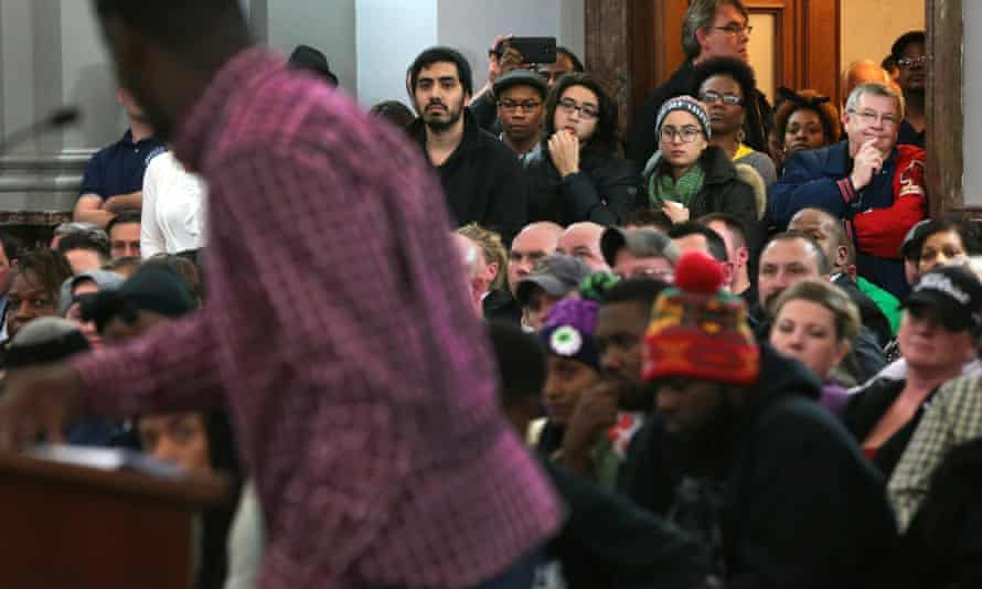 Members of an overflow crowd attend a committee meeting proposing a civilian oversight review at City Hall. The meeting was one of several to discuss policing in the St. Louis area in the wake of the shooting death of Michael Brown by a police officer in Ferguson.