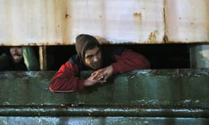 A man waits as the Ezadeen docks in Corigliano.